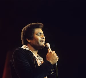 Singer Charley Pride performs on stage in the 1970's.