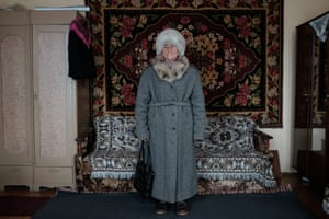 Photographs of Vera wearing clothes that tell her story by photographer Tatsiana Tkachova.