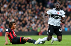 Bournemouth's Nathan Ake tackles Fulham's Aboubakar Kamara as The Cherries win 3-0 at Craven Cottage.