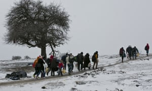 People walk from the Macedonian border into Serbia.