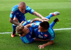 Ondrej Duda celebrates with Robert Mak and Vladimir Weiss after scoring with his first touch.