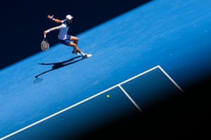 Novak Djokovic returns a shot.