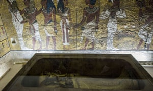 The golden sarcophagus of King Tutankhamun, pictured, in his burial chamber in the Valley of the Kings, close to Luxor, south of Cairo.