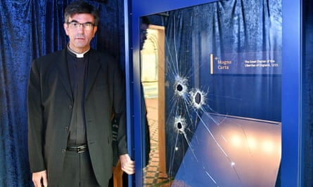 The Rev Canon Nicholas Papadopulos beside the glass case that houses a Magna Carta