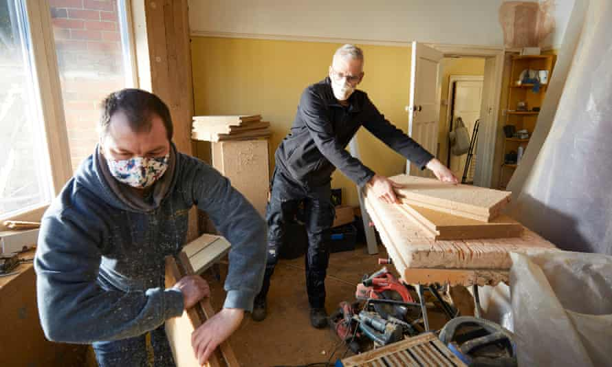 Charlie Baker (right) and Alan Tierney retrofitting a house in Whalley Range, Manchester. The pioneering scheme has no government or council backing.