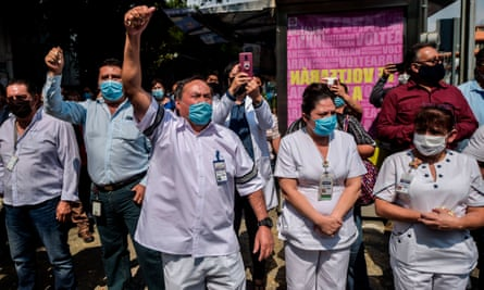 Health workers of 20 de Noviembre hospital bid farewell to stretcher-bearer Hugo López Camacho, who died of Covid-19, in Mexico City, on Monday.
