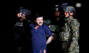 "Soldiers escort drug lord Joaquin ""El Chapo"" Guzman in Mexico City, January 8, 2016."