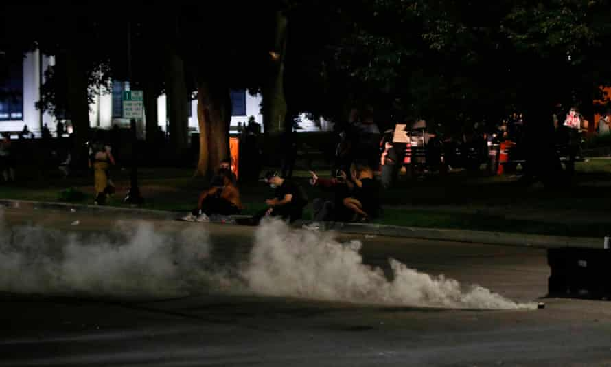 Police use tear gas against protesters demonstrating against the shooting of Jacob Blake .