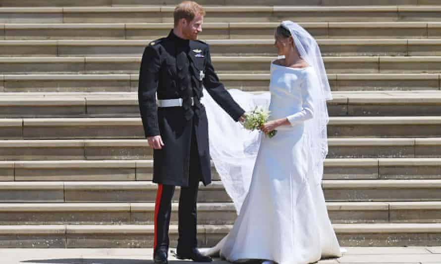 Prince Harry on his wedding day with Meghan Markle in a dress designed by Clare Waight Keller.
