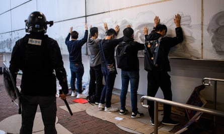 Hong Kong police detain people in December 2019 after a rally to show support for the Uighur minority in China.