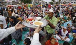 Indian Muslims prepare to break their fast at an Iftar hosted by market traders in Ahmadabad.