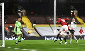 Fulham's goalkeeper Alphonse Areola makes a save from Manchester United's Bruno Fernandes.