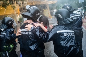 Police officers carry a girl out of a collapsed school after Typhoon Mangkhut landed on Hong Kong. With winds as fast as 200km per hour, Mangkhut made landfall in the Philippine province of Cagayan late on 14 September as a category five-equivalent super typhoon
