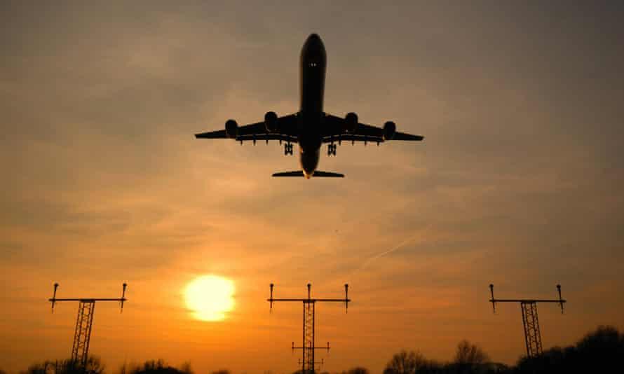 A passenger plane arrives at London Heathrow.