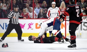 Alex Ovechkin stands over Andrei Svechnikov after their fight on Monday night
