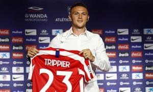 Kieran Trippier poses with his Atlético Madrid shirt after signing for the club in July 2019.