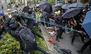 A homemade slingshot is used to fire bricks at the Tseung Kwan O police station.
