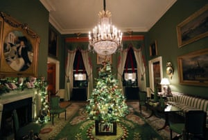 A small decorated Christmas tree stands in the middle of the Green Room at the White House.