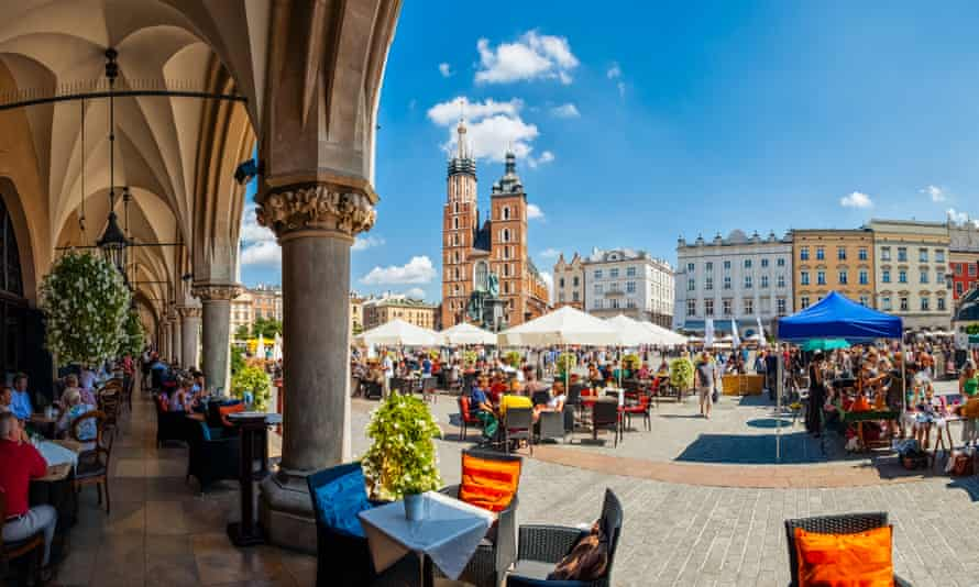 Main market square of Krakow from under the arches of the Cloth Hall.