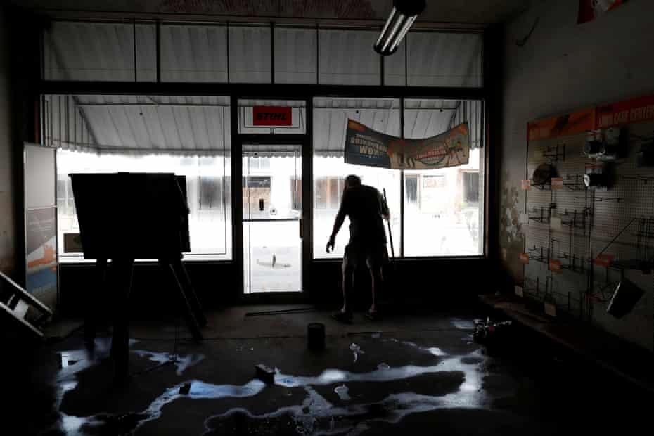 Randy Britt works to clean one of his downtown buildings after flooding due to Hurricane Florence receded in Fair Bluff, North Carolina, U.S. September 29, 2018.