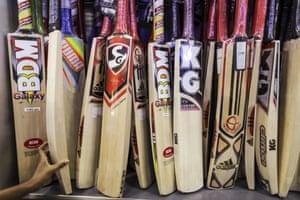 A batsman chooses his weapon of choice.