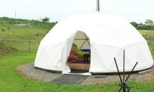 canvas geodesic dome in a plot of grassy land