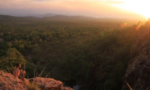 The sun sets over Kakadu national park, viewed from the top of Gunlom falls, in Australia's Northern Territory.