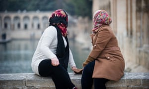 Two Syrian sisters who rescued a Yazidi slave photographed in Turkey where they fled in fear of their lives because of their role in freeing the young woman.