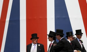 Racegoers wearing traditional top hats at Royal Ascot's 2015 meeting.