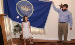 PRINCESS EMILY<br>Jeremiah Heaton and his seven year-old daughter, Princess Emily, show the flag,July 2, 2014, in Abingdon, Va,  that their family designed as they try to claim a piece of land in the Eastern African region of Bir Tawil. (AP Photo/Bristol Herald Courier, David Crigger)