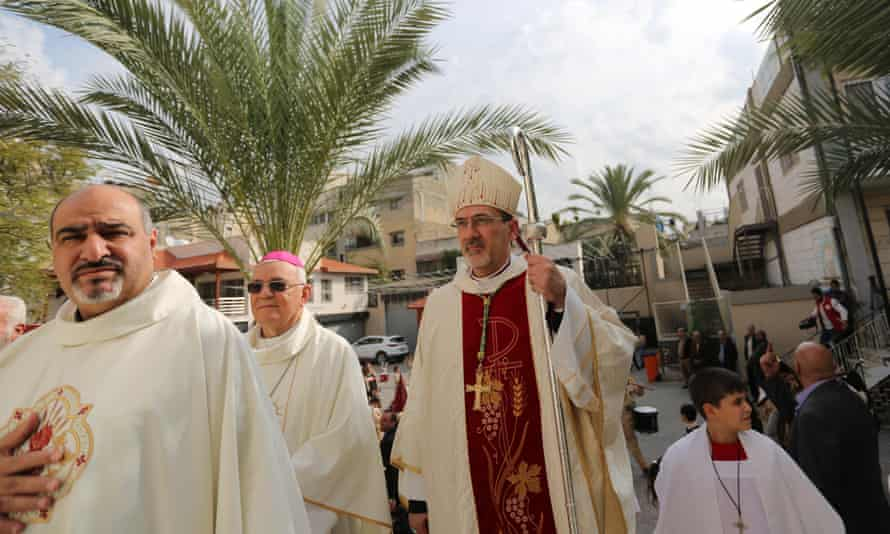 Archbishop Pierbattista Pizzaballa arrives to lead a mass at the Holy Family Church in Gaza City.
