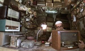 An Iraqi man repairs radios in Baghdad. Photograph: Reuters