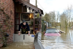 David, a resident in Bewdley, looks out of his property as flood barriers fail to hold back the River Severn