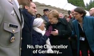 Angela Merkel with a woman at an armistice event