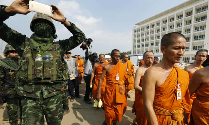 A Thai soldier takes a photograph during the search of the Dhammakaya complex