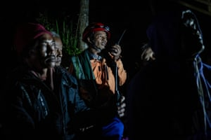 Villagers use a walkie talkie as they monitor seismic events of Mount Merapi