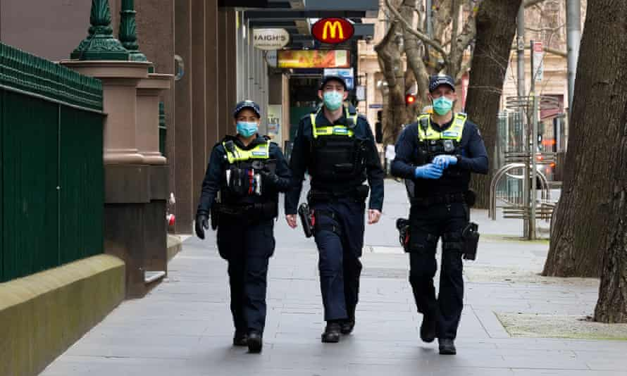 Victorian police patrol Melbourne's CBD as the city continues under stage 4 coronavirus restrictions. Two of the organisers of an anti-lockdown rally have been charged with incitement.