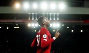 Liverpool's Divock Origi celebrates scoring their third goal.