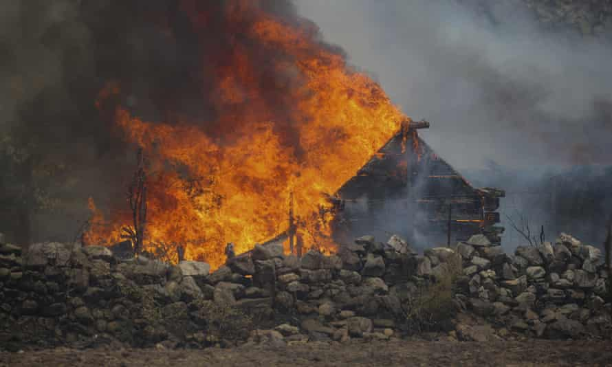 A fire engulfs a house in the village of Cokertme, near Bodrum, in Mugla province, Turkey