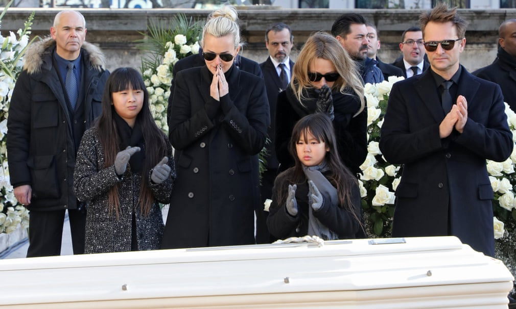 Johnny Hallyday's wife and children stand in front of his coffin outside La Madeleine church in Paris