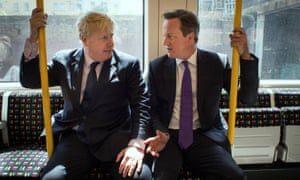 David Cameron and Boris Johnson sit on an underground train after local election campaigning