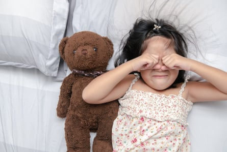 Little girl looking upset on bed (Posed by model)