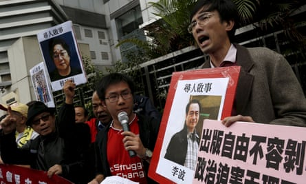 Pro-democracy protesters in Hong Kong with a picture of Lee Bo
