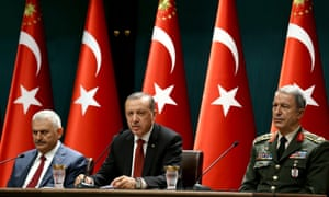 President Recep Tayyip Erdoğan (C), with the prime minister, Binali Yıldırım, (L) and chief of staff, General Hulusi Akar, at a press conference in Ankara after the failed coup.