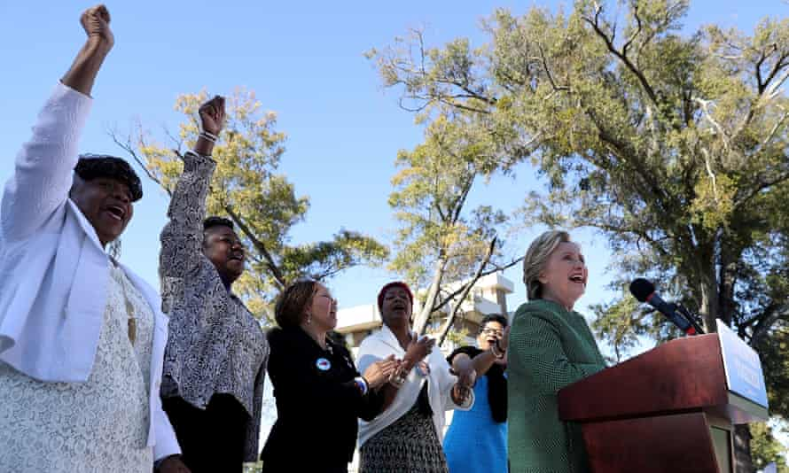 Mothers of the Movement members Gwen Carr, Sybrina Fulton, Lucia McBath, Maria Hamilton and Geneva Reed-Veal cheer as Hillary Clinton speaks during a campaign rally at Saint Augustine's University on Sunday in Raleigh, North Carolina.