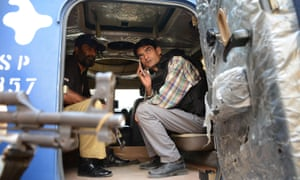 Crime reporter Zille Hyder at the scene of a gun battle between police and militants in Ali Town, Karachi