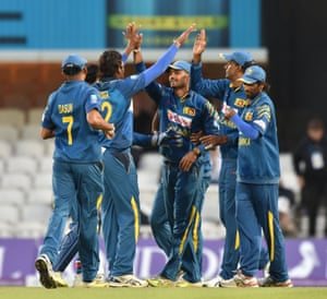 Sri Lanka's Danushka Gunathilaka, centre, celebrates with his team-mates after his stunnig catch to dismiss England's Eoin Morgan.