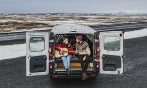 Couple in a camper van in Iceland