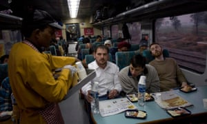 Passengers being served breakfast on the Delhi-Agra Shatabdi Express.