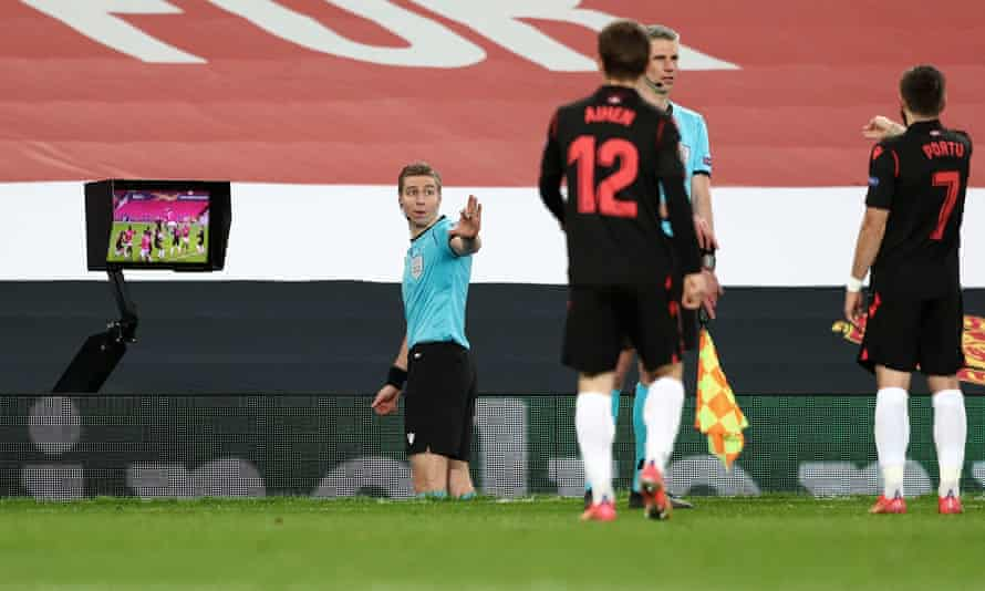 The referee Lawrence Visser consults the monitor before disallowing a Manchester United goal against Real Sociedad.